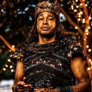 An actor standing in costume during a performance of Midsummer Night's Dream in 2021