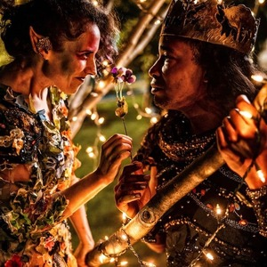 Two actors talking during a performance of a Midsummer Night's Dream